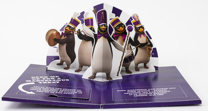 Cadburys pop-up invitation featuring a brass band of penguins