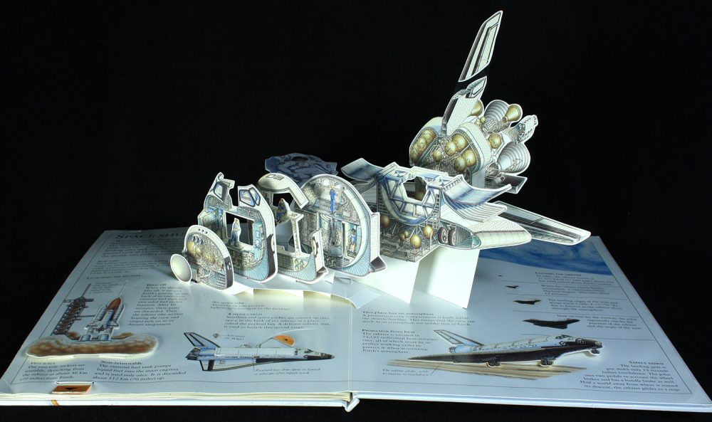 DK pop up book page that features a cross section of a spaceship