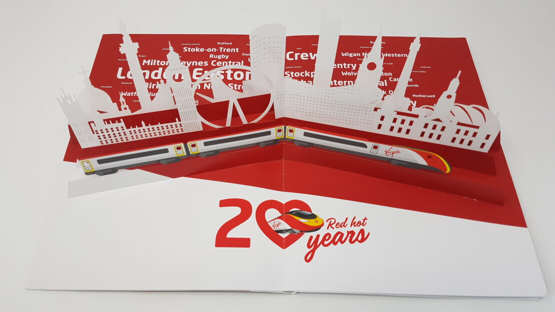 pop up cityscape and train in Virgin Trains' pop up brochure