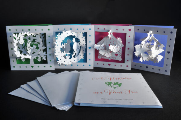 Pop-up Christmas cards (all four and cover)